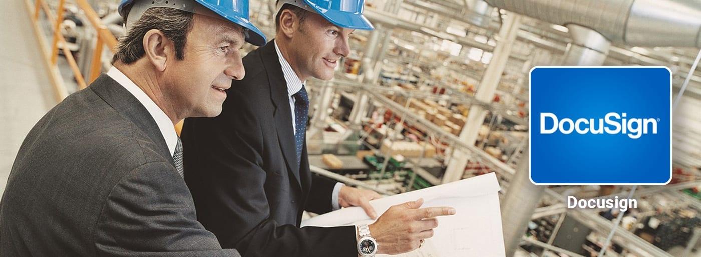 Business men warehouse hardhats